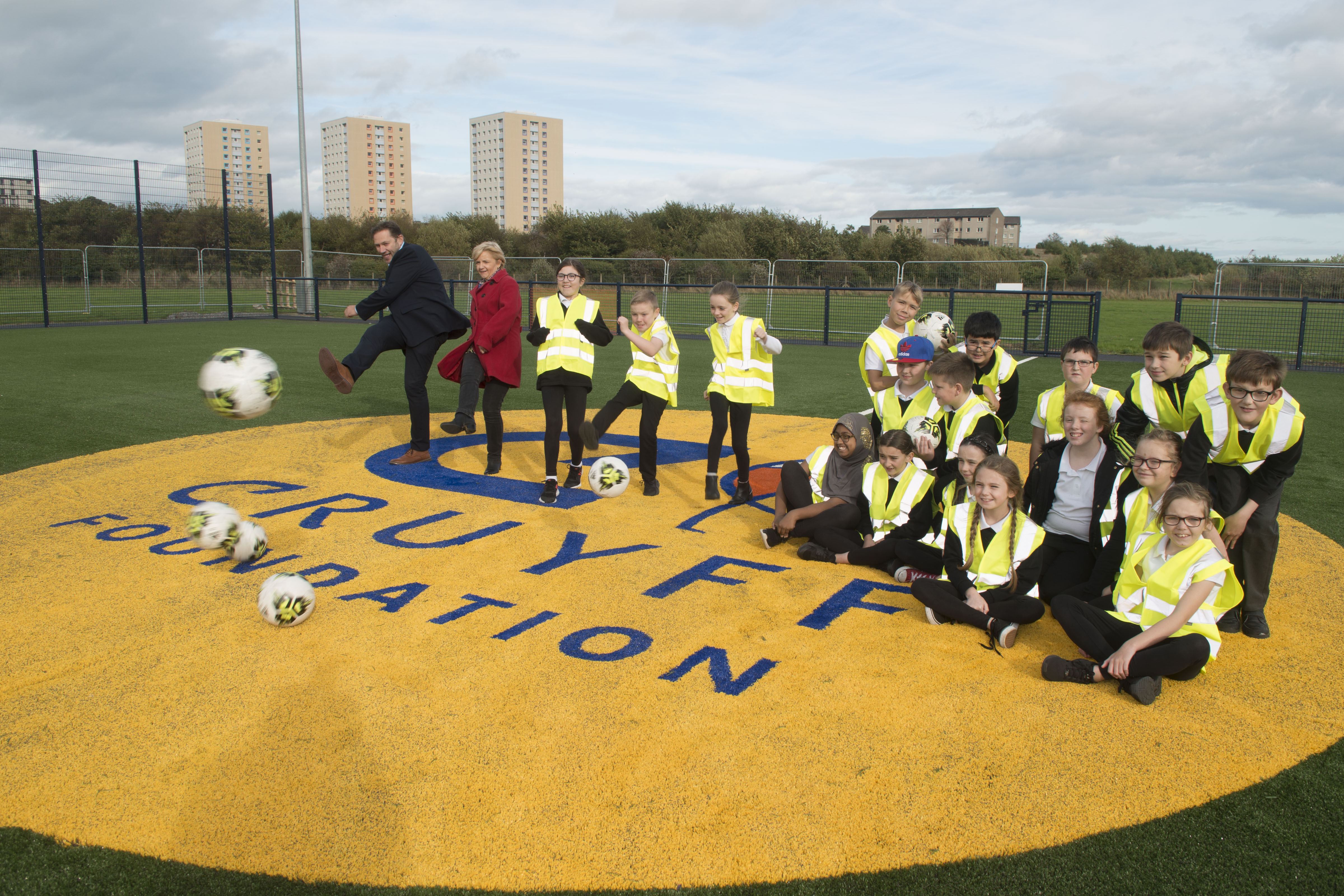 Aberdeen City Council Co-Leaders Cllr Jenny Laing and Cllr Douglas Lumsden join pupils of Tullos Primary School in trying out the new Cruyff Court Neale Cooper.