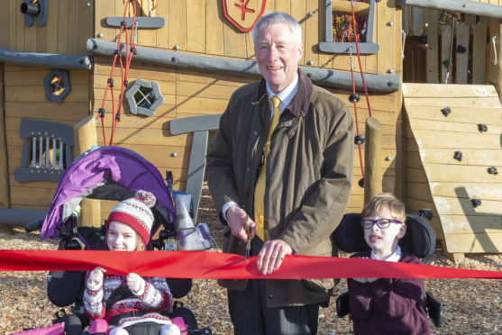 Iona and Findlay James-Bruce with Provost Bill Howatson at the Aden Country Park playpark opening.