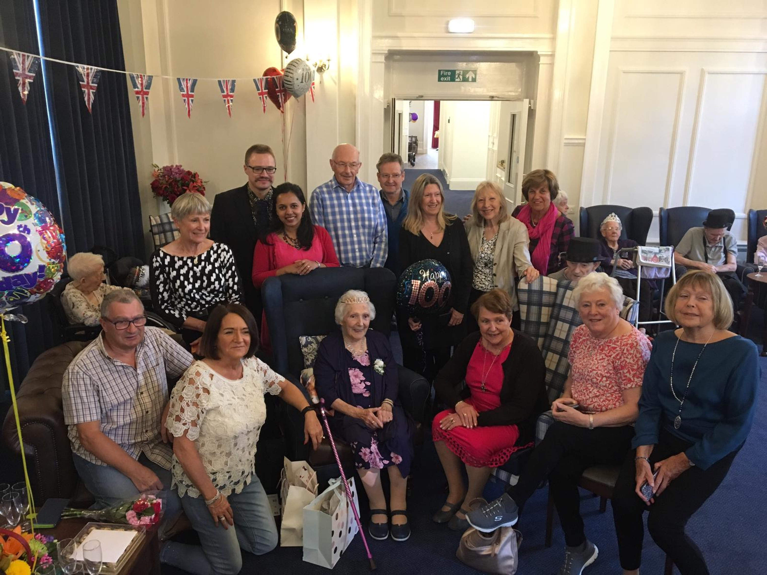 Beryl Booth surrounded by family  and friends