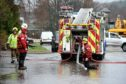 Flooding in Ballater. Fire fighters try to unblock the drains at the caravan park.