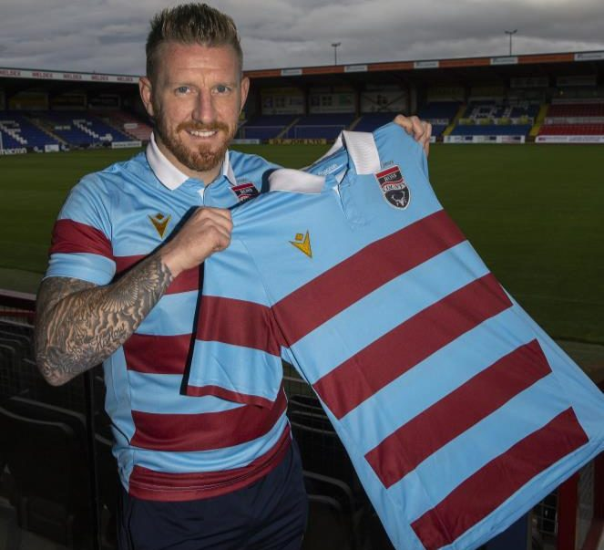 Michael Gardyne unveils Ross County's commemorative 90-year anniversary strip.
