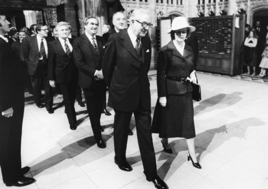 Prime Minister James Callaghan and Leader of the Opposition Margaret Thatcher, followed by Denis Healey and William Whitelaw, engaged in conversation as they leave the House of Commons, London, November 1st 1978. (Photo by Central Press/Hulton Archive/Getty Images)