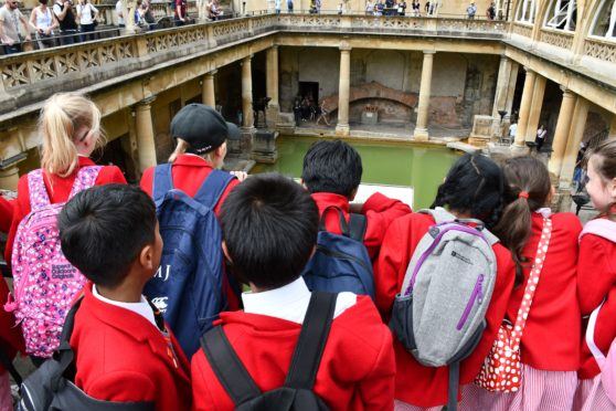 Elementary School Students at Roman Baths, Bath, England. (Photo by: Education Images/Universal Images Group via Getty Images)