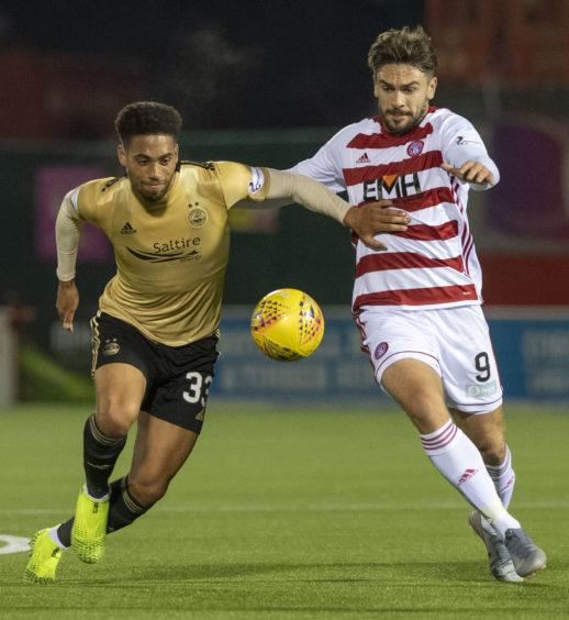 Aberdeen's Zak Vyner battles with Hamilton's George Oakley.