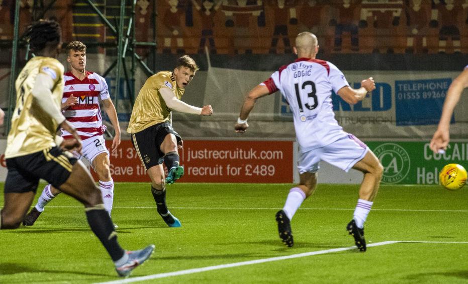 Aberdeen's Lewis Ferguson scores the games only goal.