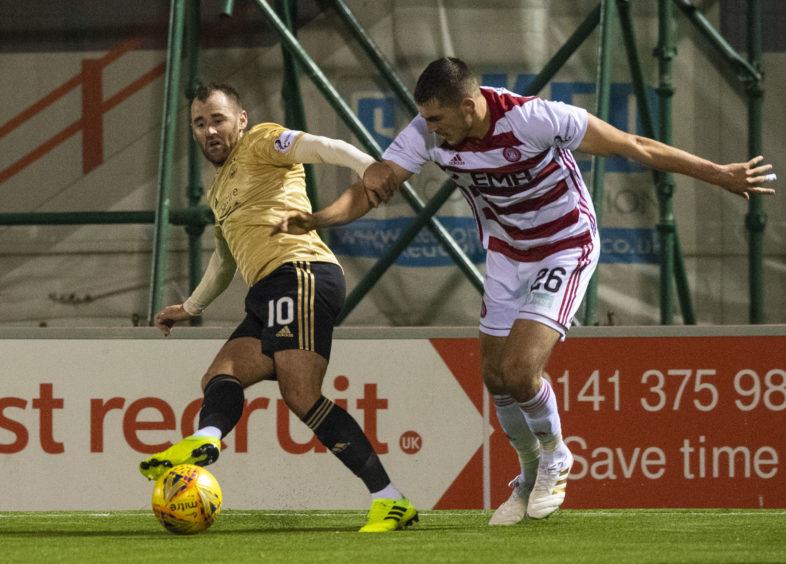 Aberdeen's Niall McGinn  tussles with Hamilton's Sam Stubbs.