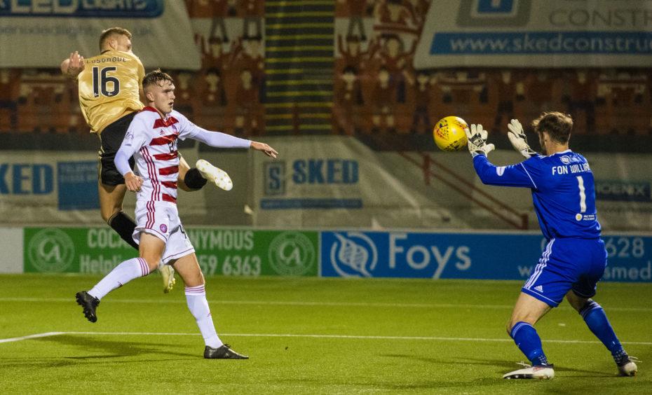 Aberdeen's Sam Cosgrove, left, sees his header saved by Hamilton's Owain Fon Williams.