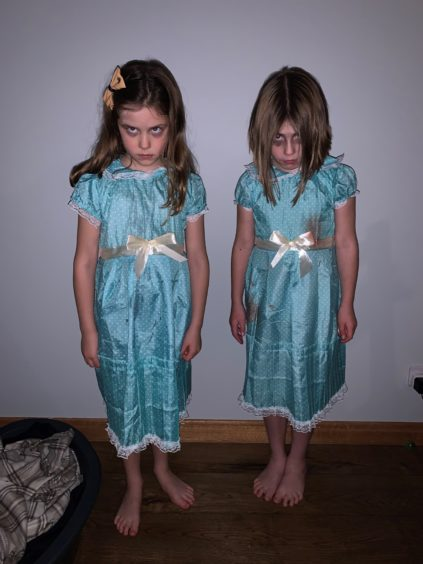 Katie Fraser on the left and her cousin Maddie Muir, both from Stonehaven. They are dressed up as the twins from The Shining