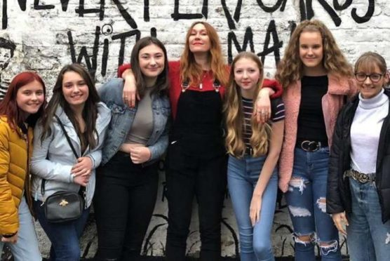From left to right: Mearns Academy pupils Logan Forbes, Jessica Murdoch, Ellen Smith, radio DJ Mickey Beans, Niamh Harris, Aimee Macdonald and April Barham