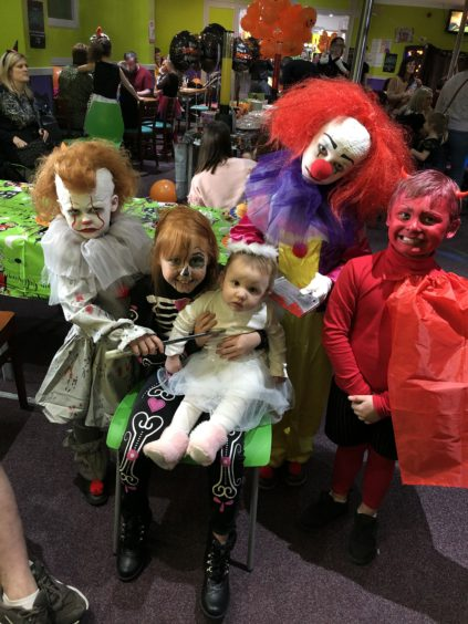 Evelyn (clown), Faith (skeleton), Aila (angel), Riley (clown) & Ayden (devil)!