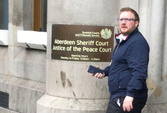 John Thomson leaving Aberdeen Sheriff Court.