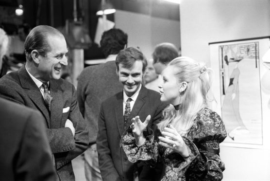 """Prince Philip, The Duke of Edinburgh talks to producer, Reg Watson, and actress Jane Rossington during his visit to the set of """"Crossroads"""", at ATV Studios. Miss Rossington plays the role of Jill Richardson in this long running serial."""