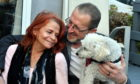 Charlie, the miniature poodle, with owners Susan Martinez and Keith Webster. Pictures by Chris Sumner