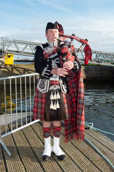 Piper Calum Fraser performed at the dedication to the new vessel in Invergordon. Picture by Jason Hedges