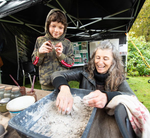 Callum Stables, 8 from Keith is pictured with Becky Little from Rebirth Building who is running an Dorodango making stall. Picture by JASON HEDGES