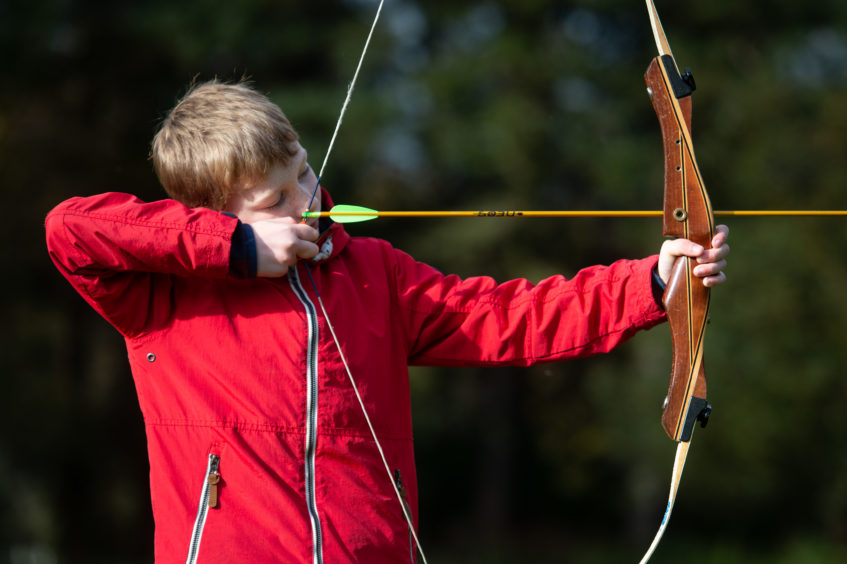 Alan Breen, 9 is participating in Archery ran by Outfit Moray. Picture by JASON HEDGES