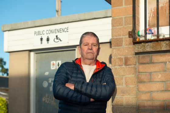 Buckie Councillor Gordon Cowie is pictured at the Buckie Public toilets on Newlands Road which are one of the loos set to close at end of September.   Pictures by JASON HEDGES