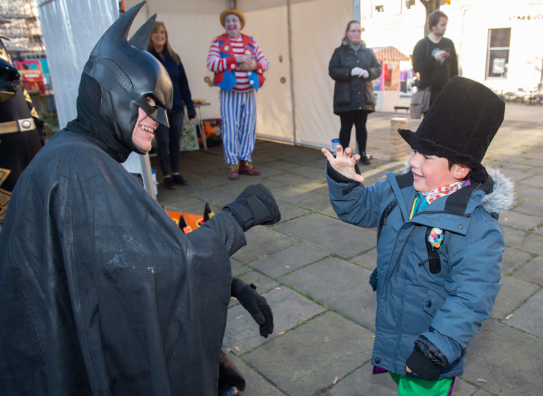 Starstruck Ruben Evans, pictured right, 5, with Batman Aidan Wilson. Picture by Jason Hedges