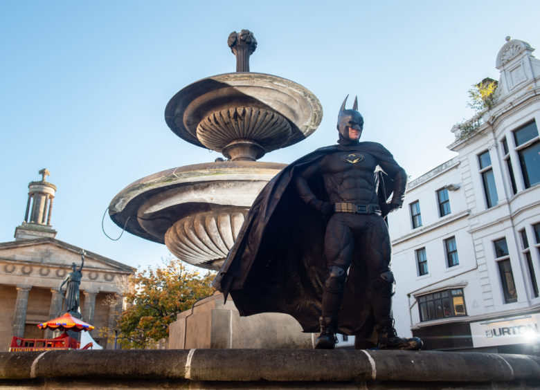 Batman, Aidan Wilson, from Keith at the fountain in Elgin town centre.  Picture by Jason Hedges