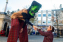 Frankenstein from Hop Scotch Magic in Drumnadrochit with Grace Fudge, 5, from Elgin. Picture by Jason Hedges.