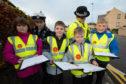 Evie Joss-Allan, Kai Balmer, Keelan Kearns with RAF Police Cpl. Lea Clevett and PC Miller.