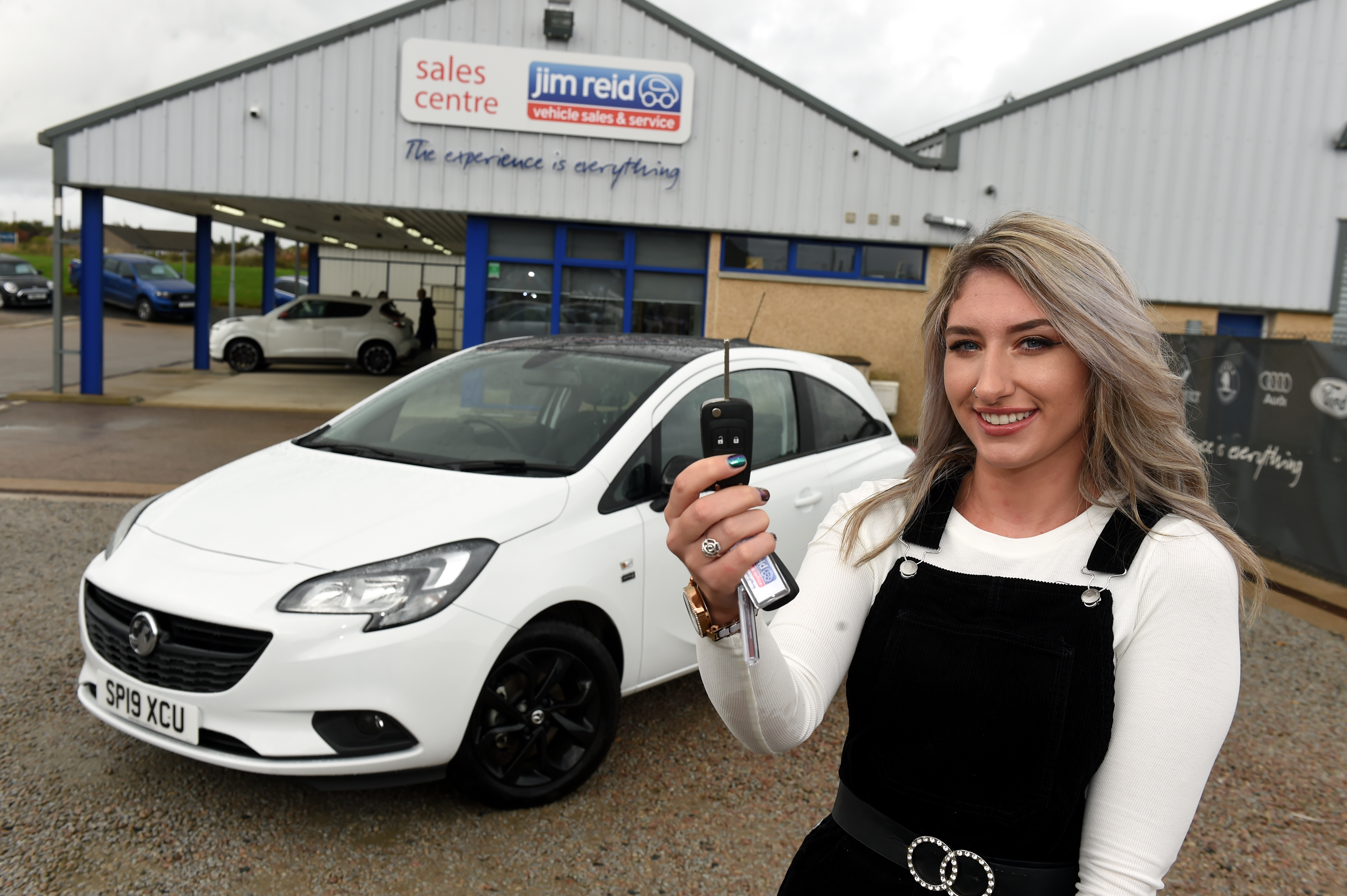 Raffle winner Nicole Anderson collecting her car.