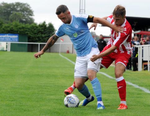 Rothes midfielder Gregg Main (left).