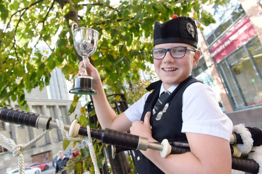Archie Johnston of Mull with the Roderick Ross, Ferintosh, Memorial Trophy for piping in the under 13 age groups. Picture by Sandy McCook.
