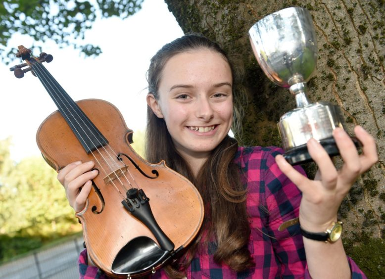 Meredith Kennedy of Glenalmond School with the Robert MacCallum Memorial Trophy for fiddle music in the 13-18 age group. Picture by Sandy McCook