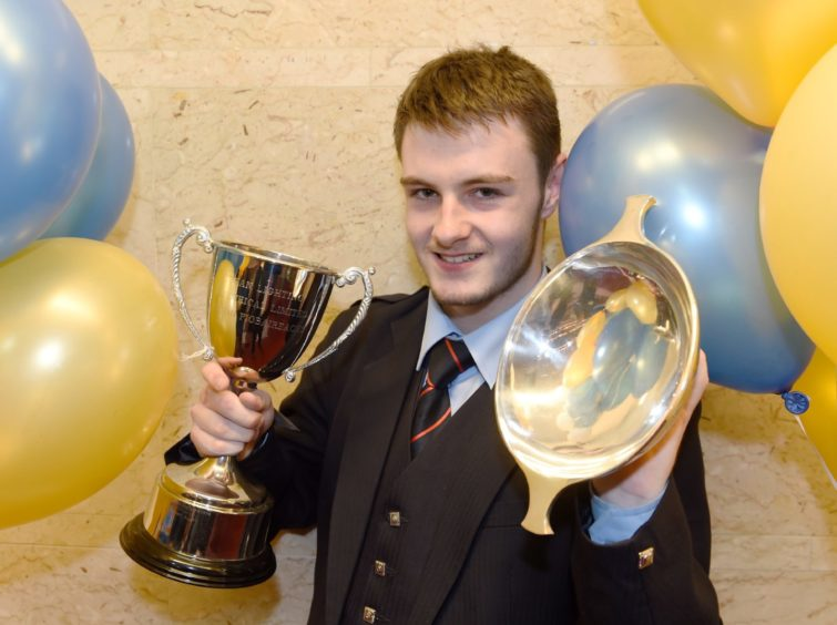 Bobby Allen of Croyston with the Lightning Electrical Cup and the Roderick Munro Quaich  for piping in the under 16 age group. Picture by Sandy McCook.