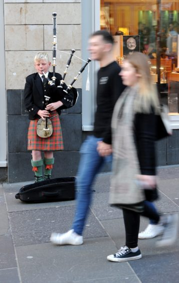 Helping pay for his piping, Logie Johnston of Mull, busking on Saturday afternoon on Buchanan Street, Glasgow. Picture by Sandy McCook.