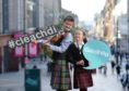 Finlay and Maili MacLennan help launch the new Gaelic Identifier campaign  -#cleachdi- at the Royal National Mod. Picture by Sandy McCook.