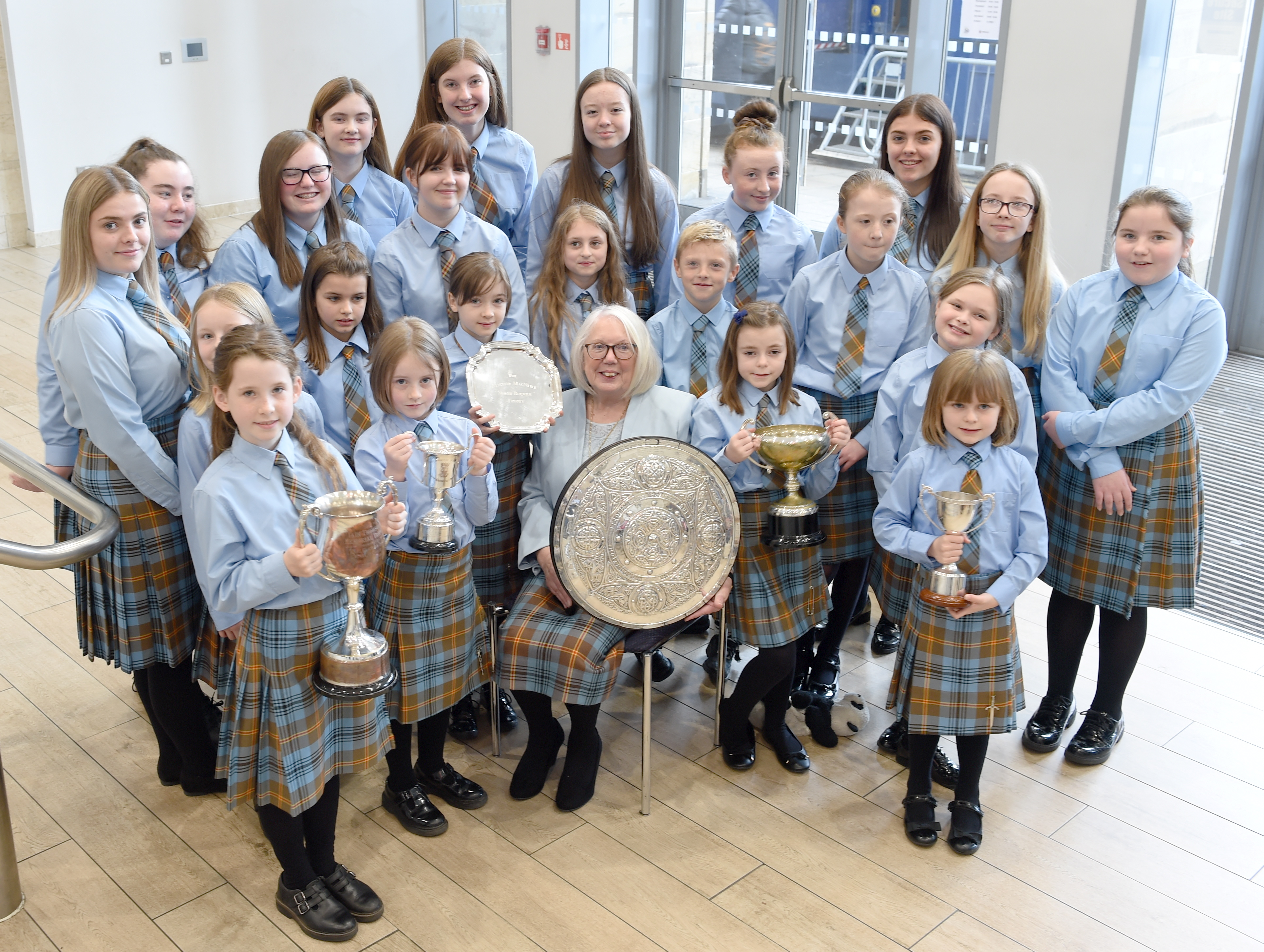 Members of the Falkirk Junior Gaelic School with their trophies and conductor Mary Maclean who herself won the Gold Medal fifty years ago at the Aviemore Mod. Picture by Sandy McCook