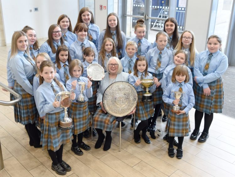 Members of the Falkirk Junior Gaelic School with their trophies and conductor Mary Maclean who herself won the Gold Medal fifty years ago at the Aviemore Mod. Picture by Sandy McCook.
