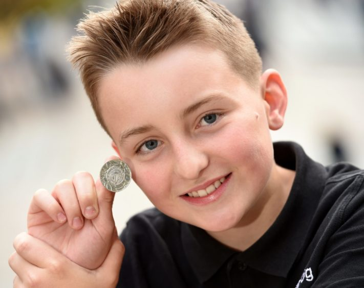 Archie Kennedy (14) of the Lochaline Choir  with the James C MacPhee Memorial Medal for solo singing. Picture by Sandy McCook.