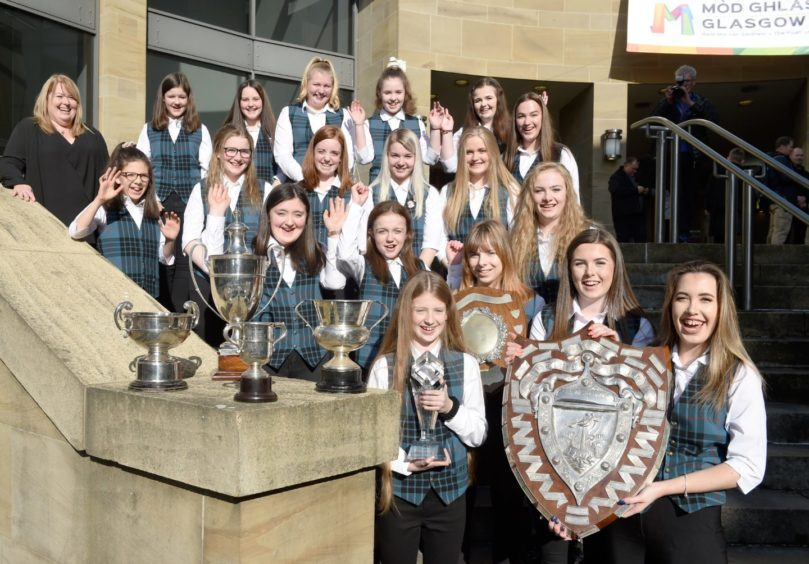 The Nicholson Institute, Stornoway choir with their haul of silverware from the choral competitions. Picture by Sandy McCook.
