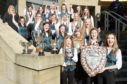 The Nicholson Institute, Stornoway choir with their haul of silverware from the choral competitions yesterday morning. Picture by Sandy McCook