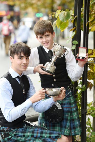 Anndra Cumming (13) of Laide, winner of the boys Traditional Silver Medal and the Ann Kelly Macdonald Memorial  Trophy in the 13 -15 age group while also in the photograph is his brother Eoin (16), winner of the 16-18 age group for traditional singing with the Neil MacLaine Cameron Memorial Trophy. Both are pupils of Gairloch High School in Wester Ross. Picture by Sandy McCook.