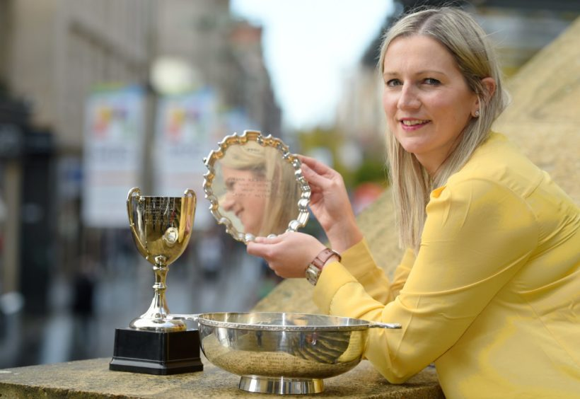 Claire Macaulay of Glasgow and Ness, Lewis, winner of the Mary C MacNiven Memorial Salver, Mr and Mrs Archibald MacDonald Memorial Trophy and the Joyce Murray Trophy in the Oran Mor. Picture by Sandy McCook.