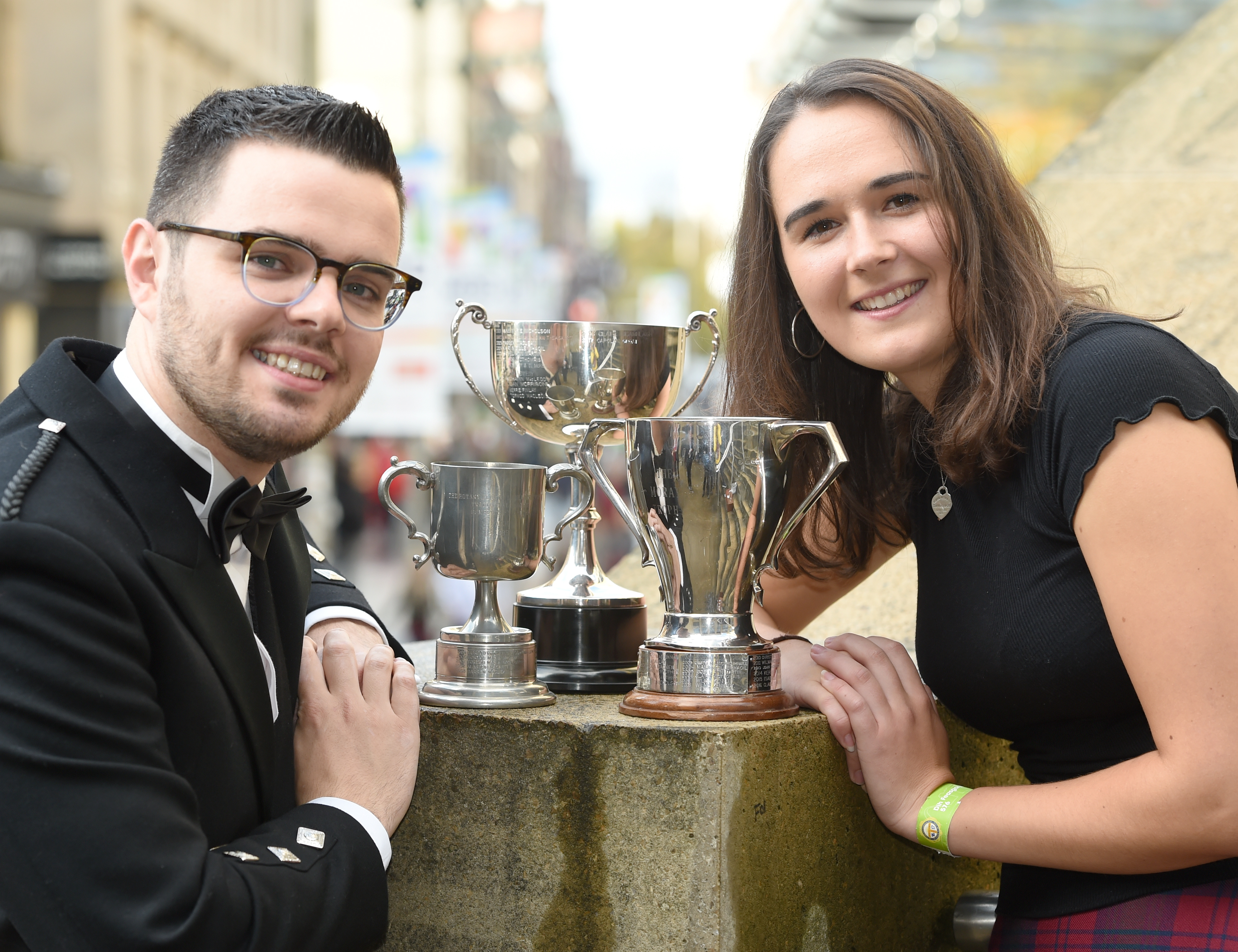 Isabelle Bain of Back in Lewis, winner of the Moray Trophy for traditional singing and ALasdair Iain MacPhee of Glasgow with the Rotary Club of Lochaber Trophy in the mens competition. They shared the Donald Murray Memorial Trophy for gaining the highest marks in their combined competitions. Picture by Sandy McCook