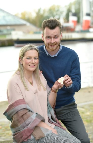 Gold Medal winners Claire Macaulay of Glasgow and Ness, Lewis and Ruairidh Alastair MacLennan of Glasgow photographed beside the River Clyde with their medals. Picture by Sandy McCook.