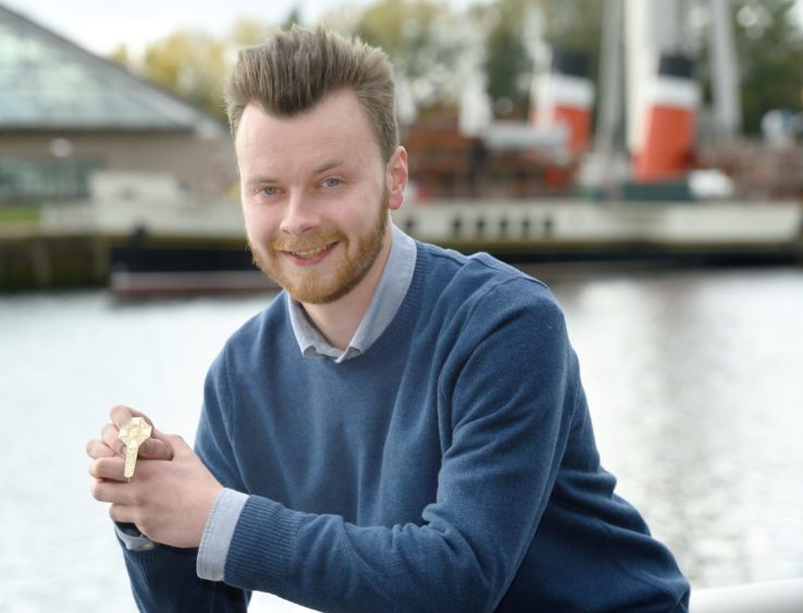 Gold Medalist Ruairidh Alastair MacLennan of Glasgow photographed beside the River Clyde with his medal. Picture by Sandy McCook.