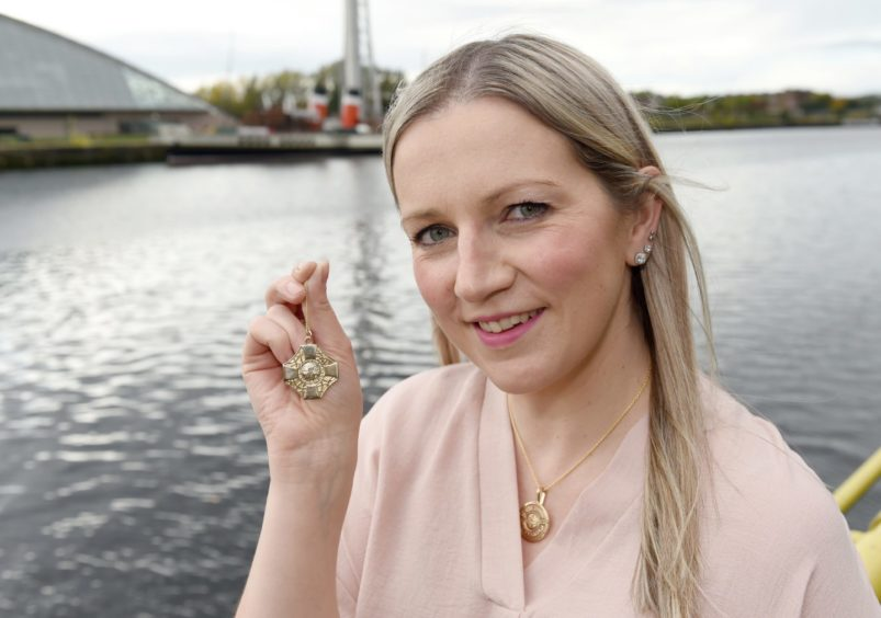 Gold Medal winner Claire Macaulay of Glasgow and Ness, Lewis photographed beside the River Clyde with her award. Picture by Sandy McCook.