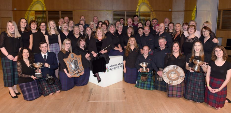The combined choirs of Lewis based Back Gaelic Choir and west coast based Burach celebrate their successes in the Royal Concert Hall, Glasgow in the rural choirs competition. Picture by Sandy McCook.