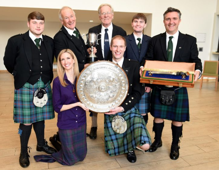 Conductress Joy Dunlop of Taynult with members of her men's choir Coisir Ceann an Tuirc who won the Mull and Iona Shield , The Hector Russell Dirk, The Martin Mackay Memorial Prize for choral singing. Picture by Sandy McCook.