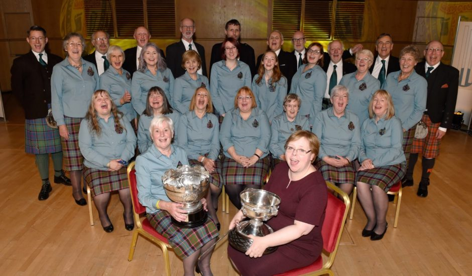 Winners of the Margrat (correct) Duncan Memorial Trophy, Stirling Gaelic Choir with their conductor Jane McQueen (front right) with the trophy while front left is Anne Steven, Gaelic reader with the choir holding the John McNicol Memorial Trophy for the highest marks in Gaelic. Picture by Sandy McCook.
