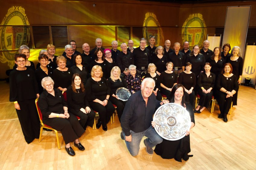 Sileas Sinclair, Conductor of the Oban Gaelic Choir with the Lovat and Tullibardine Shield for Choral singing with her choir. Also in the foreground is Brendan Graham from Ireland who wrote their winning own choice entry. Picture by Sandy McCook.