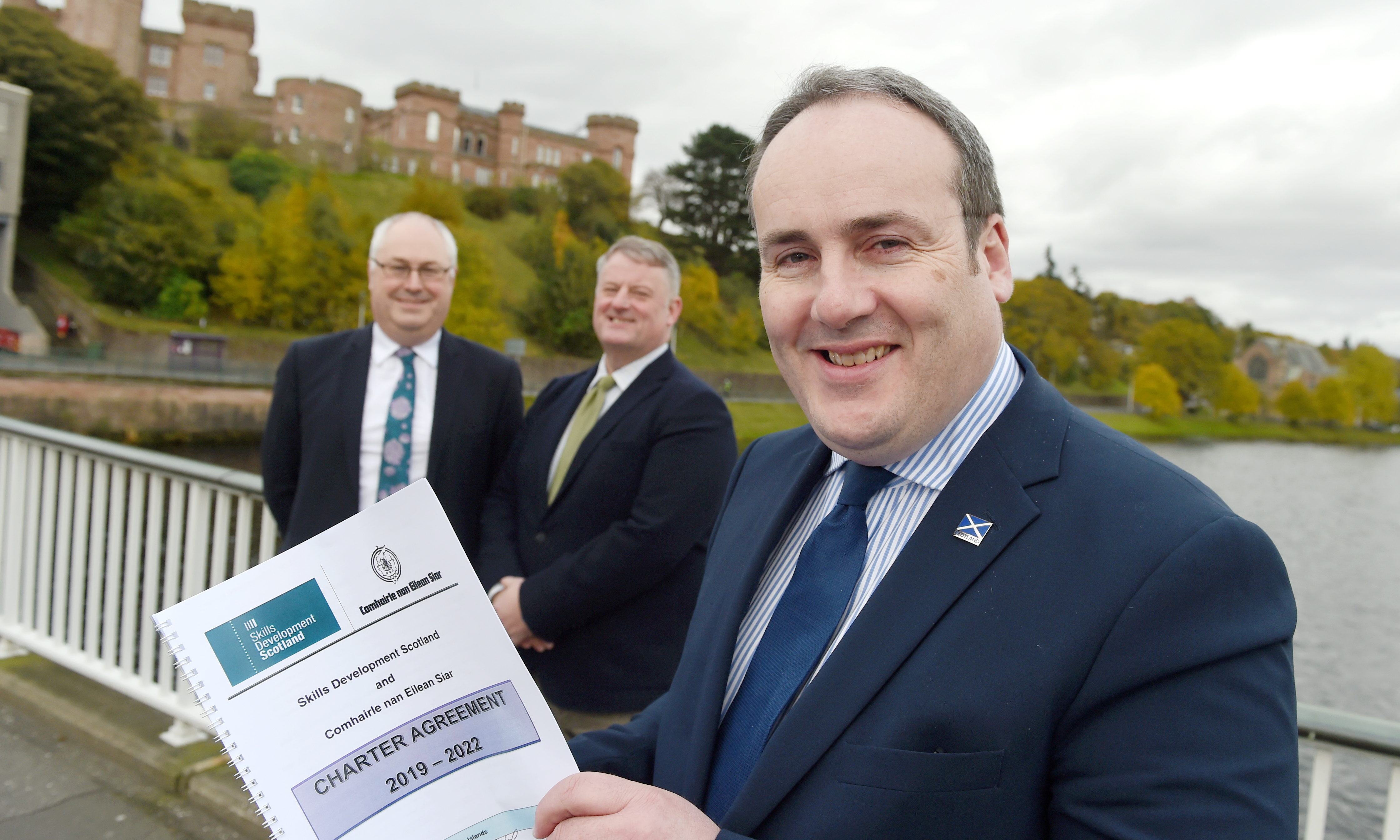 Scottish Government Minister Paul Wheelhouse with Malcolm Burr, Chief Executive of Western Isles Council (left) and Frank Mitchell, Chief Executive of Skills Development Scotland as the agreement was signed in Inverness yesterday. Photo by Sandy McCook