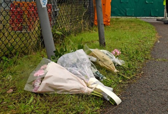 Floral tributes at the Waterglade Industrial Park in Grays, Essex, after 39 bodies were found inside a lorry on the industrial estate.