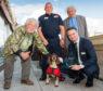 Presenter Bill Oddie, Diesel's handler Gary Carroll, host Lord Desai (standing) and crouching bottom right IFAW UK Director James Sawyer